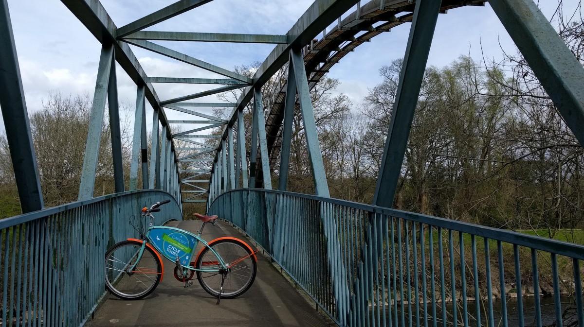 bike on a bridge over the river taff