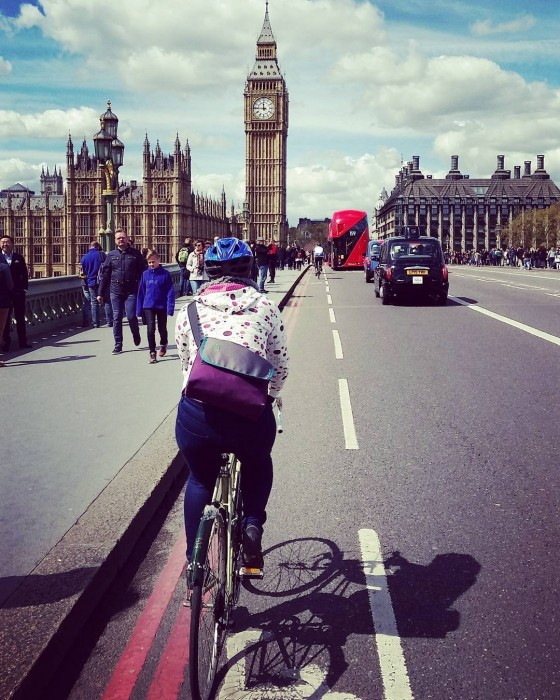 Ellen riding toward Parliament on the Westminster Bridge