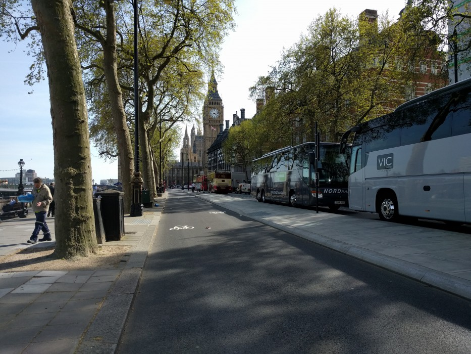 Cycling on the East West Cycle Superhighway approaching Big Ben and Westminster